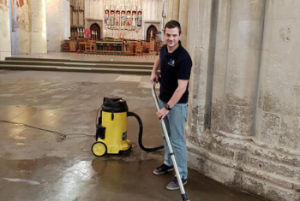 member of Scott & Sons team carefully cleaning a cathedral floor
